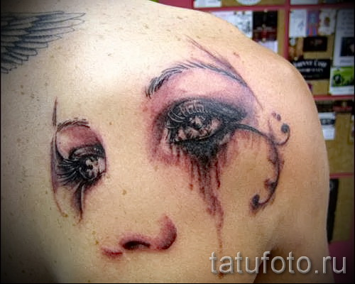 Тату слеза под глазом - пример на фото -  8