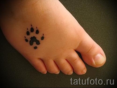 Тату лапа медведя пример на фото - маленькая тату внизу женской ноги