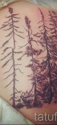 Тату лес на лопатке