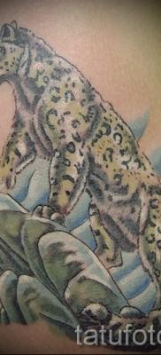 Фото тату барс – пример с животным на скале