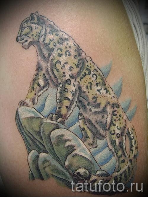 Фото тату барс - пример с животным на скале