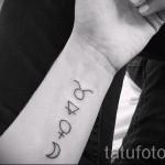 Фото готовой тату знак зодиака телец - несколько символов в столбик на руке