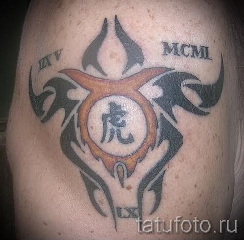 Фото готовой тату знак зодиака телец - символ и римские цифры