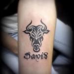 Фото готовой тату знак зодиака телец - тарайбл рисунок с надписью