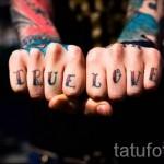тату буквы на пальцах - фото готовой татуировки - 20122015 № 14