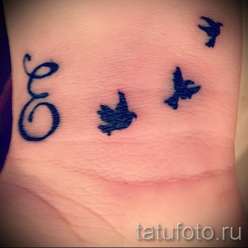 тату на кисть буквы - фото готовой татуировки - 20122015 № 10