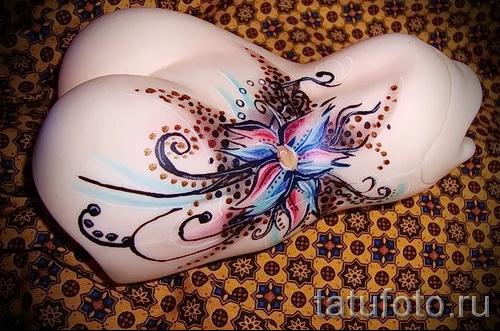 тату цветок на пояснице - фото вариант от 21122015 № 12