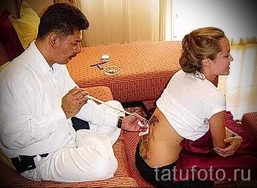 Тату Анджелины Джоли - пример на фото № 48