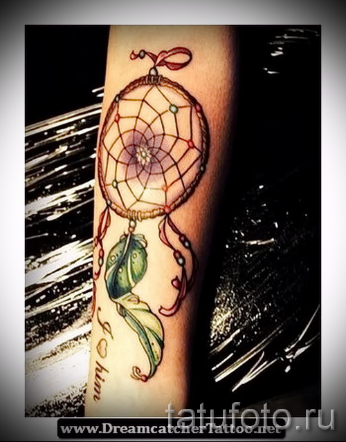 Dreamcatcher tattoo on his arm - Photo example of the number 11122014 2