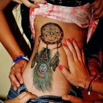 Dreamcatcher tattoo on the side - a photo example of the number 11122014 1