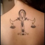 Libra tattoo on his neck - Photo example of the number 13122015 3