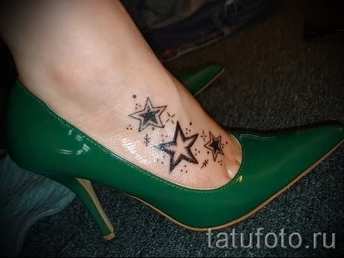 Star tattoo on his ankle photo 4