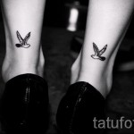 bird tattoo on his ankle - an example in the photo 2