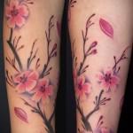 cherry tattoo on his arm 1