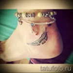 feather tattoo on his ankle photo 4