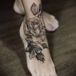 flower tattoo on his ankle - an example in the photo 1