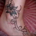 flower tattoo on his ankle - an example in the photo 2