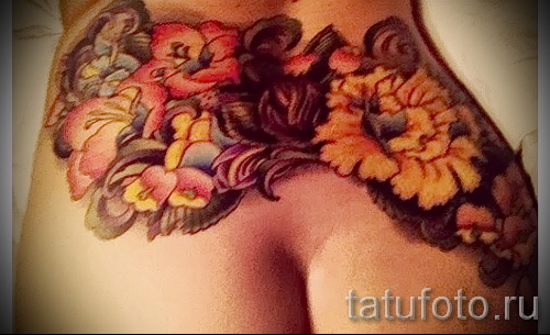 flower tattoo on the back - Picture option from the number 21122015 2