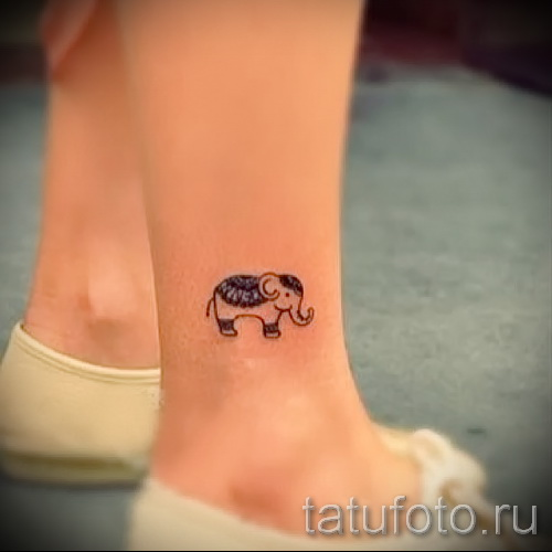 small tattoo on his ankle - an example of the photo 4