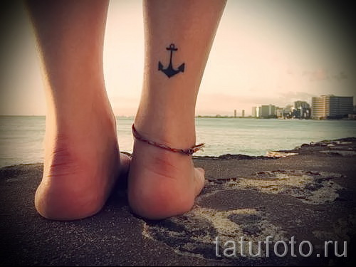 small tattoo on his ankle - an example of the photo 6