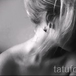 swallow tattoo behind the ear - Photo example 1