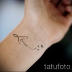 swallow tattoo on her wrist - Photo example 3
