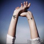 swallow tattoo on her wrist - Photo example 4