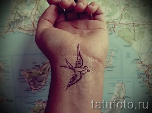 swallow tattoo on her wrist - Photo example 5