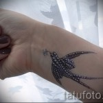 swallow tattoo on her wrist - Photo example 8