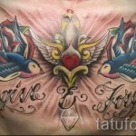swallow tattoo on his chest - an example of the photo 6