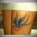 swallow tattoo on his leg - an example of the photo 4