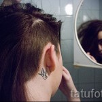 swallow tattoo on his neck - Photo example 5