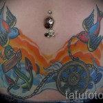 swallow tattoo on his stomach - an example of the photo 3