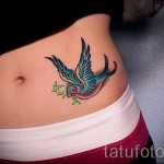 swallow tattoo on his stomach - an example of the photo 4