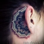 tattoo flower behind the ear 1