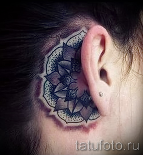 tattoo flower behind the ear 1