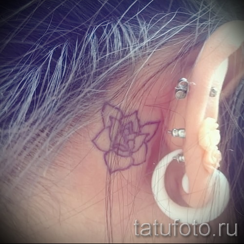 tattoo flower behind the ear 2