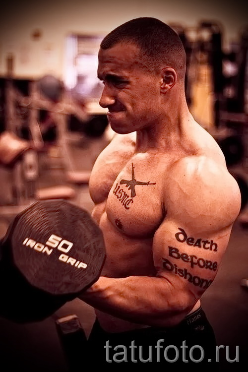 tattoo on the man's biceps Photo example 2