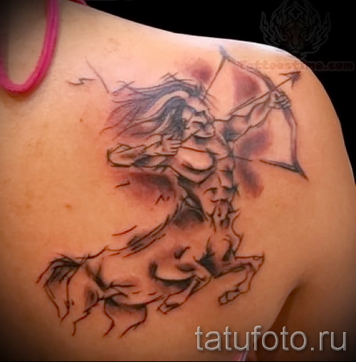 Archer tattoo on his shoulder 1