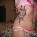 тату на ребрах цветы - фотография с примером татуировки от 03022016 2