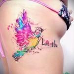 тату перо на ребрах - фотография с примером татуировки от 03022016 12