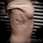 Tatouage sur les côtes - une photo avec un tatouage sur l'exemple 03022016 1