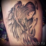 angel tattoo on the thigh 1