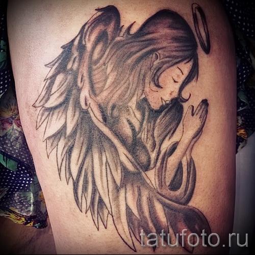 angel tattoo on the thigh 1