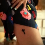 cross tattoo on his thigh 4