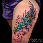feather tattoo on his thigh girls pictures 2