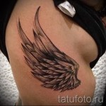 on the ribs wings tattoo - Photo example of a tattoo on 03022016 1