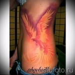 phoenix tattoo auf den Rippen - ein Foto mit einer Tätowierung auf dem Beispiel 03022016 1