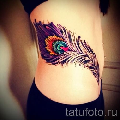plume tatouage sur les côtes - une photo avec un tatouage sur l'exemple 03022016 4