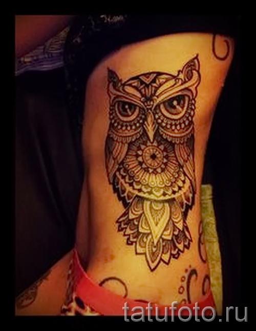 tatouage hibou sur les côtes - une photo avec un tatouage sur l'exemple 03022016 1
